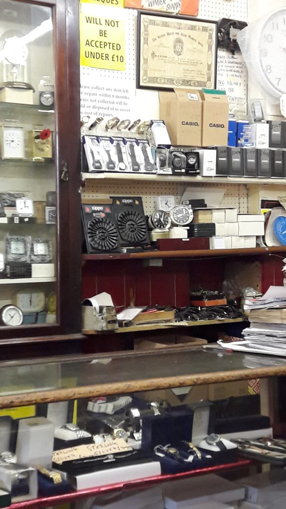 Bachulal Chotai uses the same cabinets and counters that he found in his shop when he moved in 30+ years ago. (c) Islington Faces