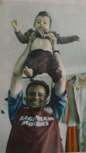 Pete May in 1999, lifts daughter Lola as if she is the FA Cup. (c) Islington Faces